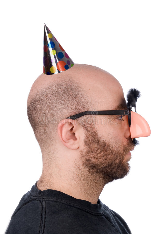 Man with fake nose and hat royalty free stock photography