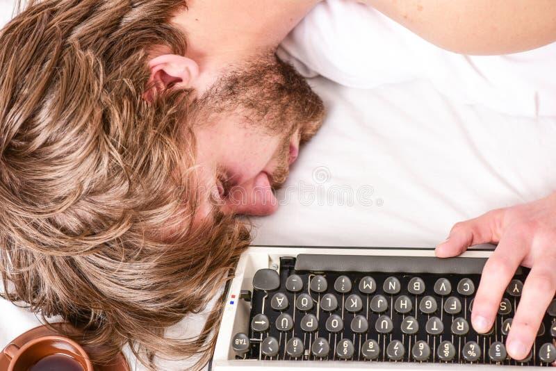 Man fall asleep. Writer used old fashioned typewriter. Author tousled hair fall asleep while write book. Workaholic fall. Asleep. Man with typewriter sleep royalty free stock photos