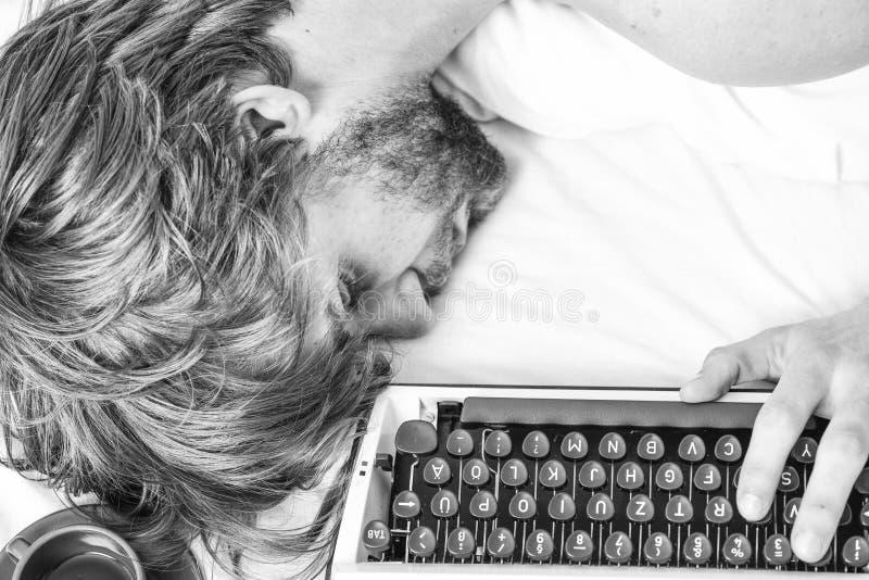 Man fall asleep. Writer used old fashioned typewriter. Author tousled hair fall asleep while write book. Workaholic fall. Asleep. Man with typewriter sleep stock photos