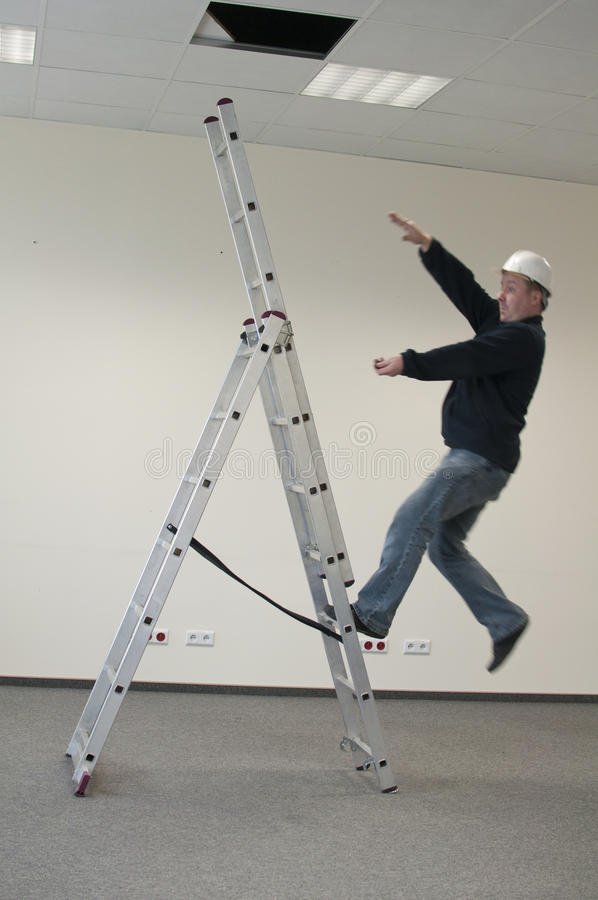 Man falls from ladder stock photo