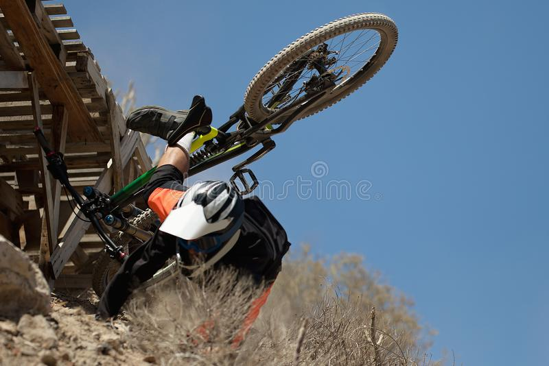 Man falls off his mountain bicycle dramatically royalty free stock photography