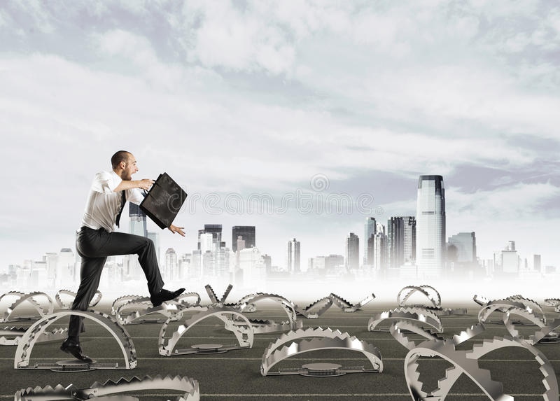 Man run in a thousand difficulties. Man falls into trap. Concept of difficulty in life and work stock images