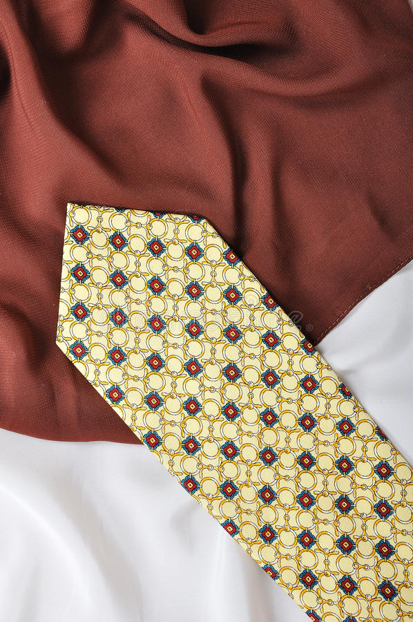 Man fashion tie on silk white. And brown cloth stock photo
