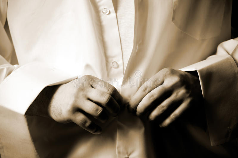 Download Man Fastening Buttons On White Shirt Stock Image - Image: 11690535