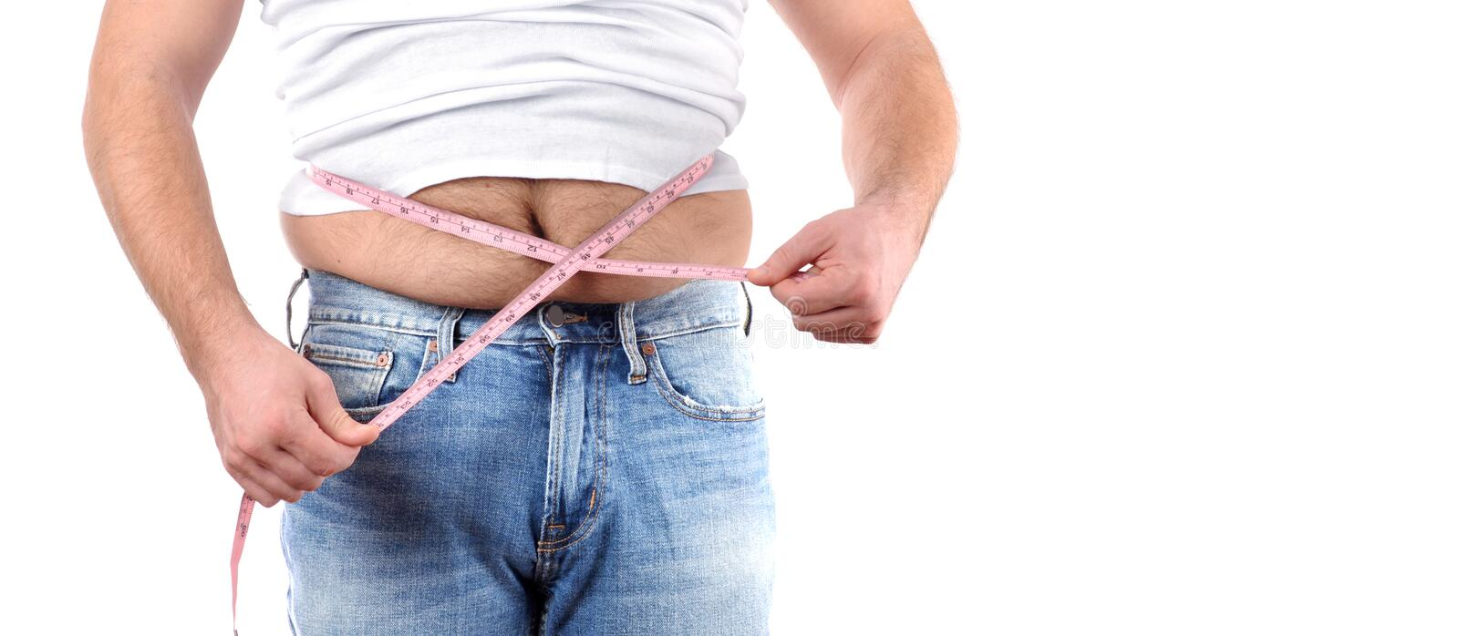 Overweight man with tape measure around waist. Man fat belly in jeans. Overweight man with tape measure around waist royalty free stock photo