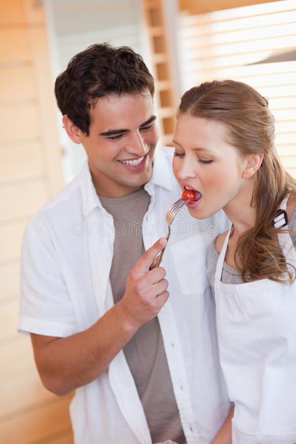 Download Man Feeding His Girlfriend With A Tomatoe Stock Photo - Image: 22221384