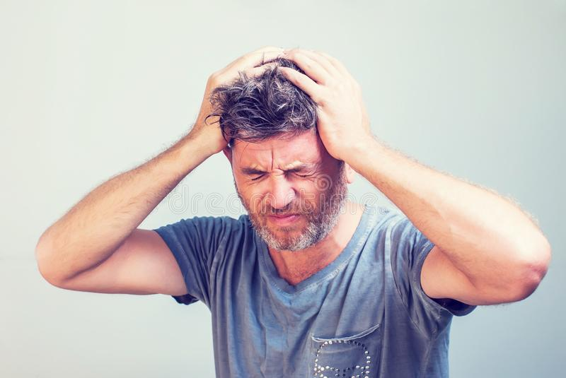 Man feel headache holding his head royalty free stock images