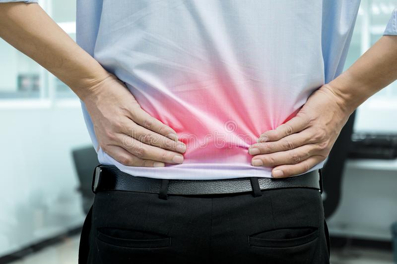 Man feeling back pain royalty free stock photography