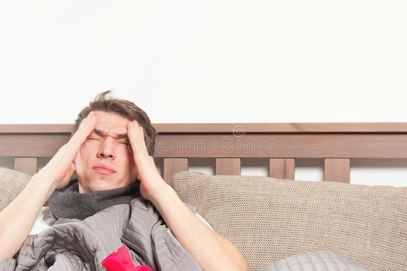 Man feeling bad lying in the bed and coughing royalty free stock images