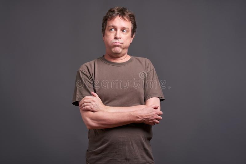 Man feeling bored. Expressions of a middle age man feeling bored stock photo