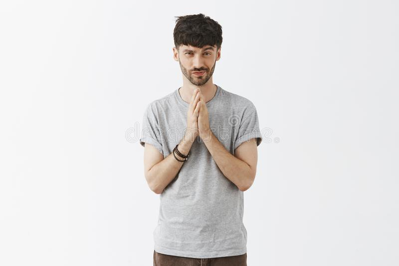 Man feeling good deal comming to his hands rubbing palms near chest smirking and gazing with pleased and satisfied. Expression at camera having great idea in stock image