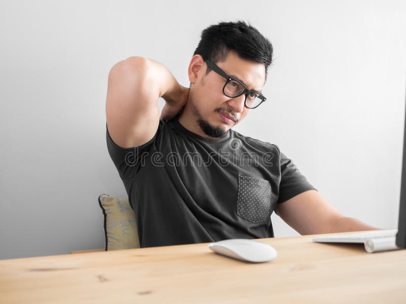 Man feeling tried with work. stock photos