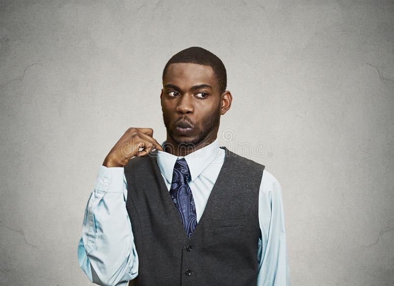 Man feels awkward, ashamed in a hot situation. Closeup portrait, young business Man opening shirt to vent, it's hot, Unpleasant, Awkward Situation, Embarrassment royalty free stock image
