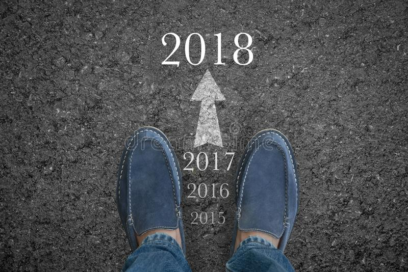 Man feet on asphalt road with start new year 2018 stock images
