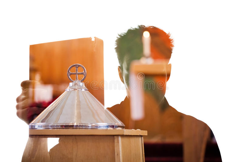 Man figure in silhouette showing a religious book royalty free stock photo