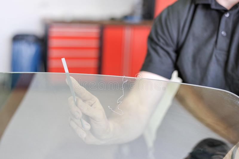 Man filing the edge of a car window royalty free stock photos
