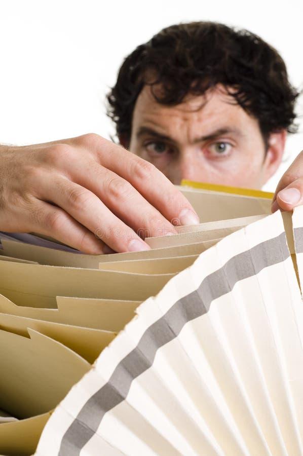 Man filing paperwork. In alphabet folder stock photography