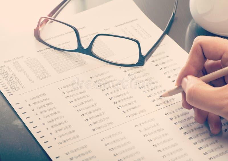 Man filling a standardized test form stock photography