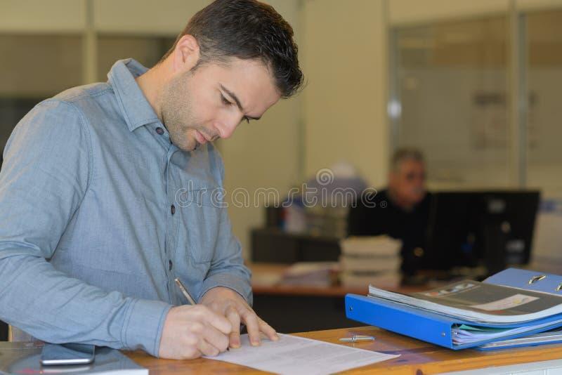 Man filling up form. Filling stock image