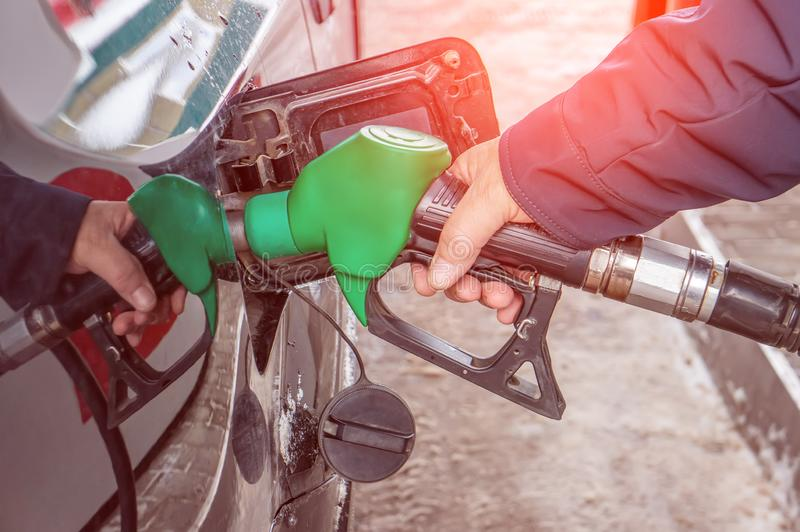 Man fills the gas tank of the car. The concept of price changes for petroleum products and petrol stock images