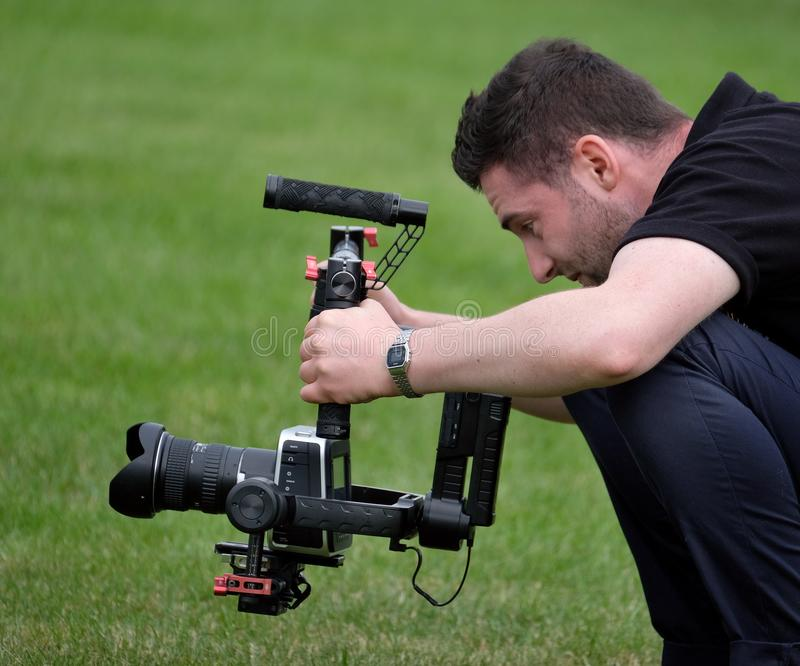 Man filming action professionally at agricultural show demonstration. The 134 th. Lincolnshire Agricultural Show, Show ground, Lincoln, Lincolnshire, UK. June stock photos