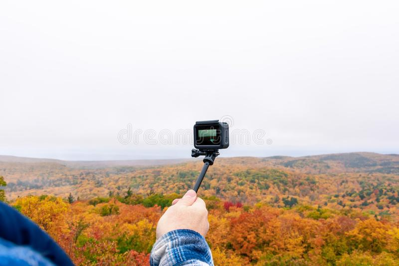 Man filming the beautiful fall colors in Michigan`s upper peninsula royalty free stock photography