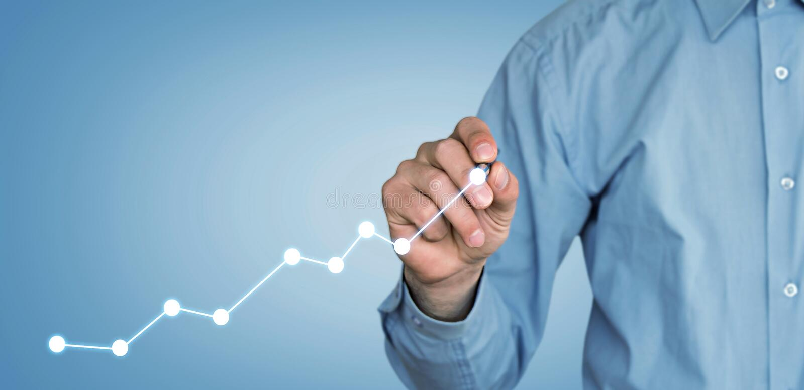 Man with financial chart. Growth concept stock photo