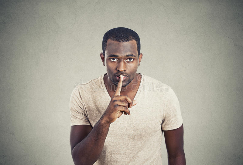 Man with finger on lips gesture keep quiet royalty free stock photo