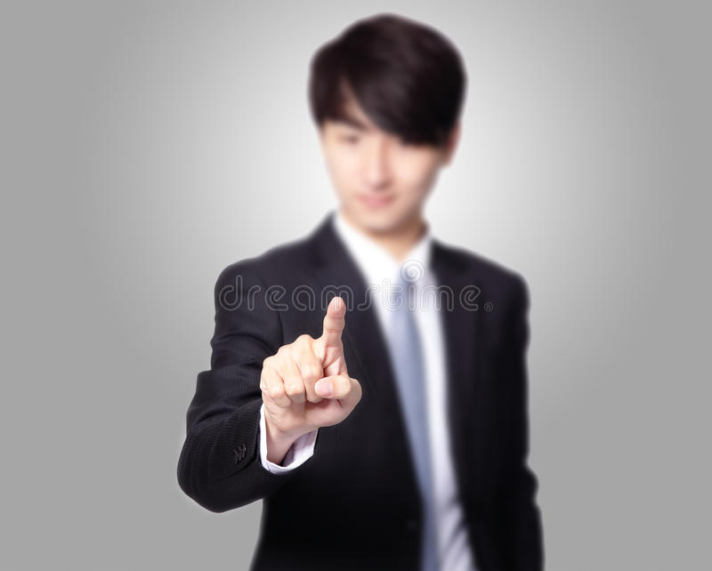 Man finger pushing touch screen interface. Business Man finger pushing on a touch screen interface, great for you add any creativity text or image, asian model stock photos
