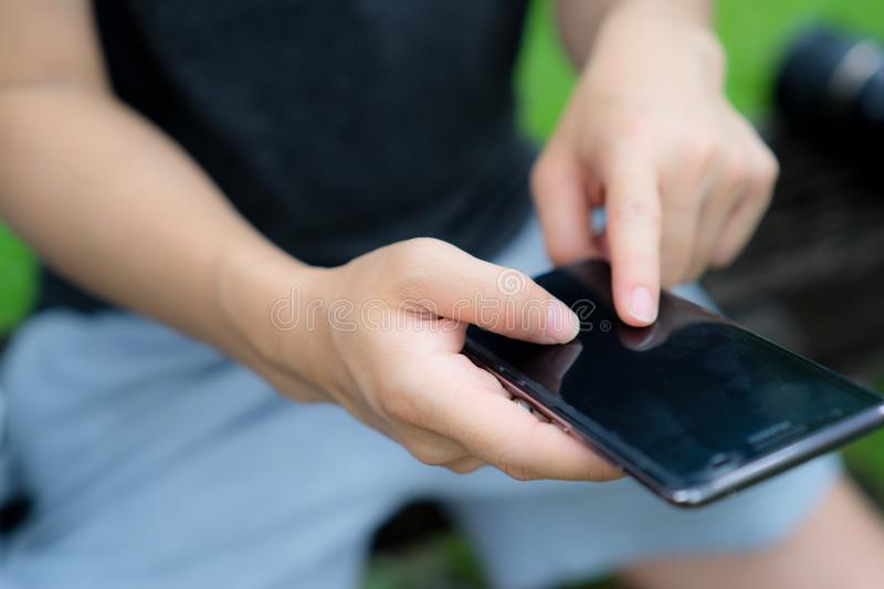 Man finger touch mobile phone screen to communicate with others stock photo