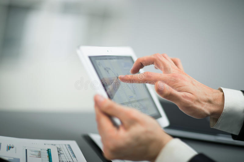 man with finger touching screen of a digital tablet stock image