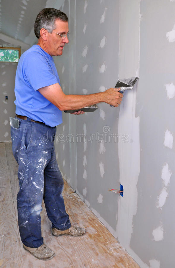 Man finishing drywall royalty free stock photos