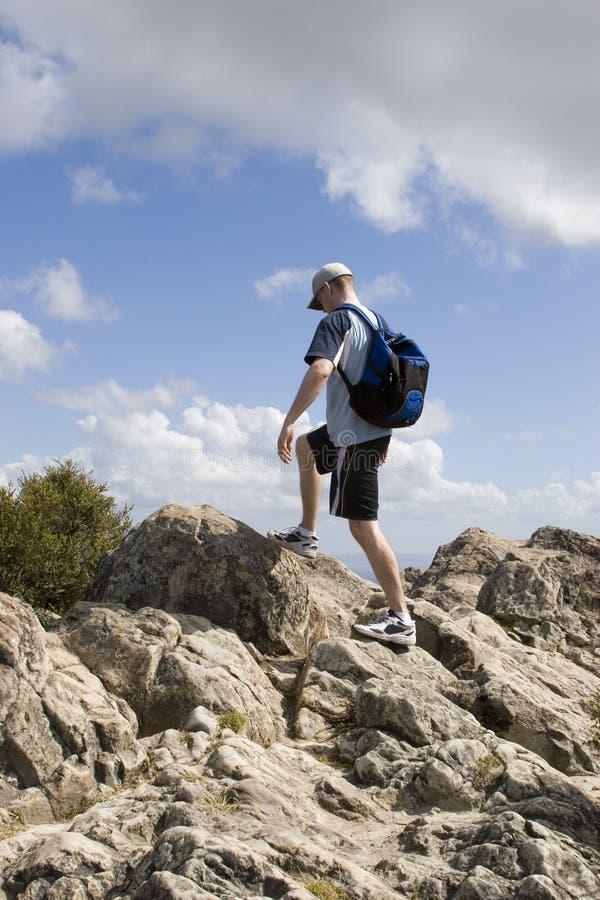Man finishing hike stock photo