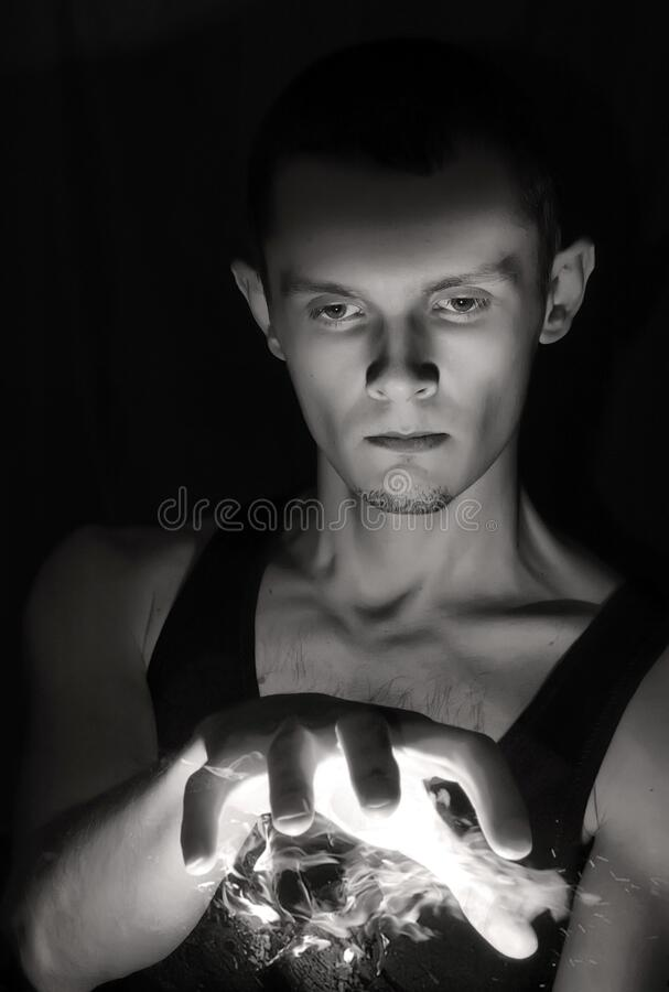 Man with fire fireball. Wizard man with fire fireball stock images