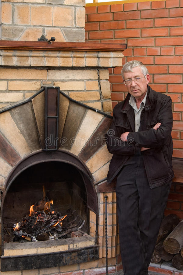 The man and a fireplace stock photography