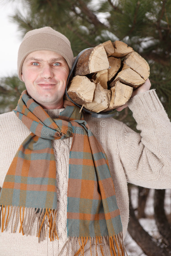 Man with firewood royalty free stock photo
