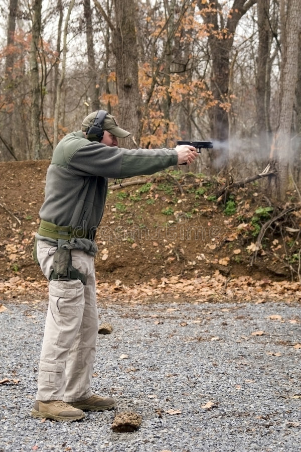 Free Man Firing Pistol Stock Photos - 3792363