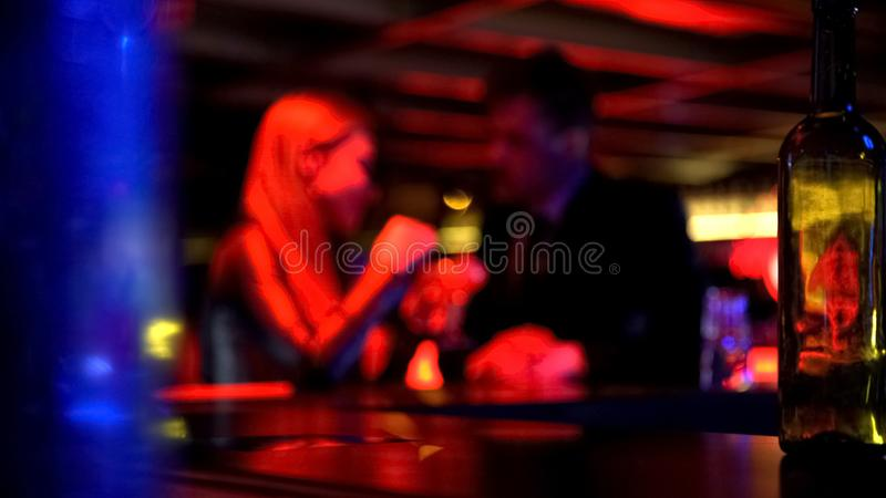 Man first meeting with lady in nightclub, talking privately, romantic atmosphere. Stock photo royalty free stock photos