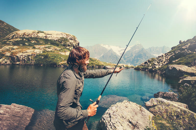 Man Fisherman fishing with rod alone royalty free stock image