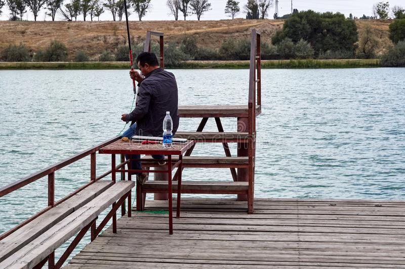 Man fishes on the lake royalty free stock photo