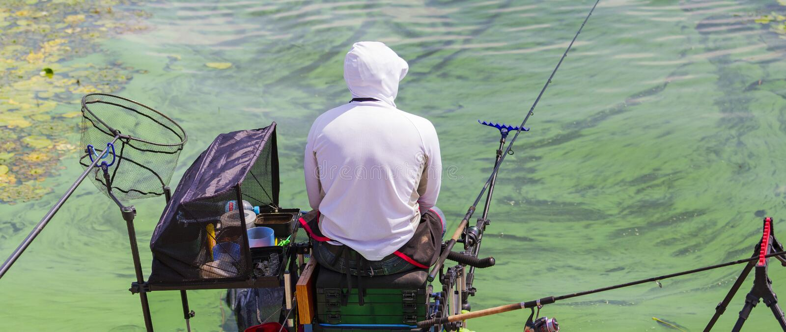 Man fishes in the river on a fishing tournament stock photography
