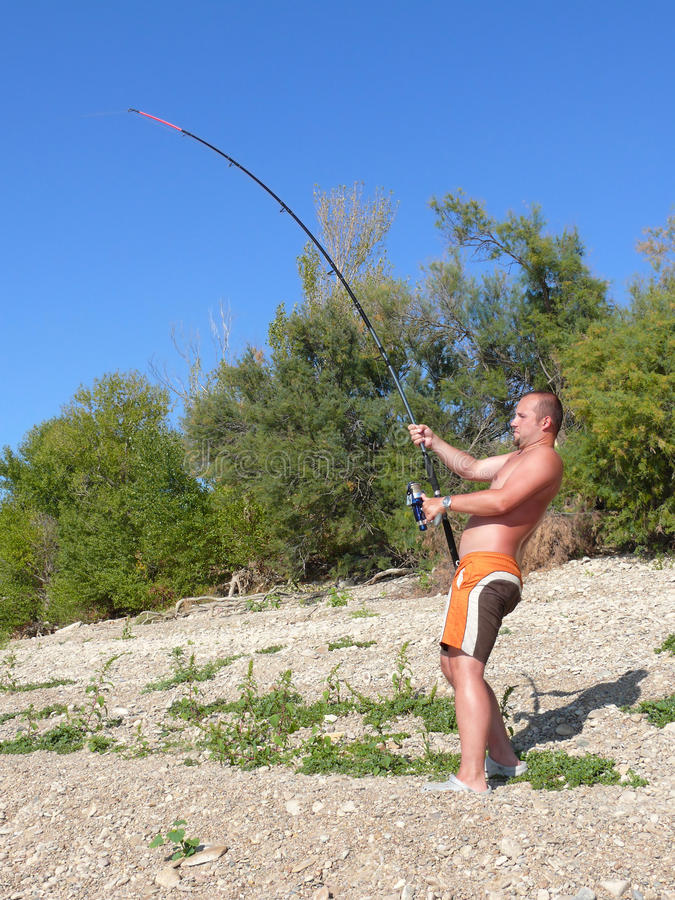 A man fishing royalty free stock images