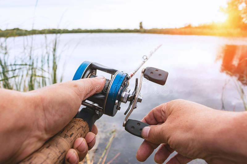 Man is fishing with a backcasting reel royalty free stock images