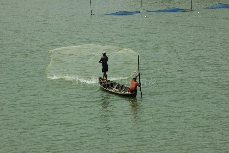 A man is fishing in a boat at the Inani Beach Rizu Canal in Bangladesh Cox& x27;s Bazar. Coxs stock photography