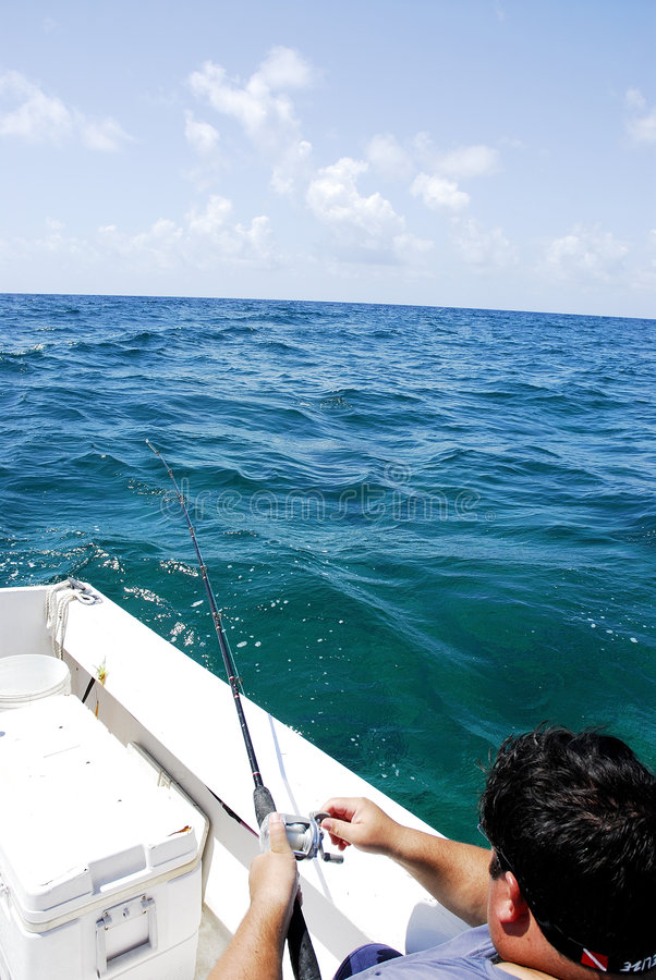 Free Man Fishing From Boat In Sea Royalty Free Stock Photography - 959527