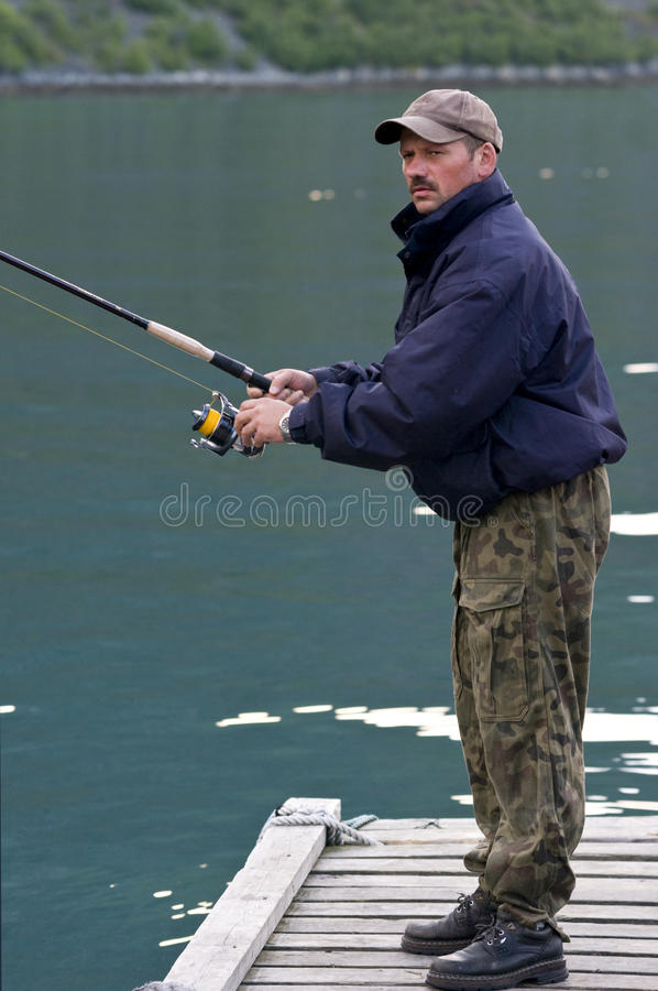 Download Man fishing on jetty stock image. Image of outdoors, recreation - 10106319