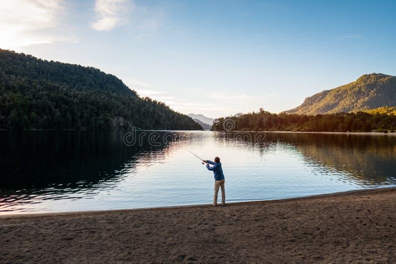 Man fishing on the lake royalty free stock image