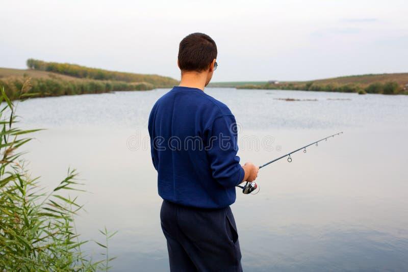 Man fishing in lake royalty free stock photography