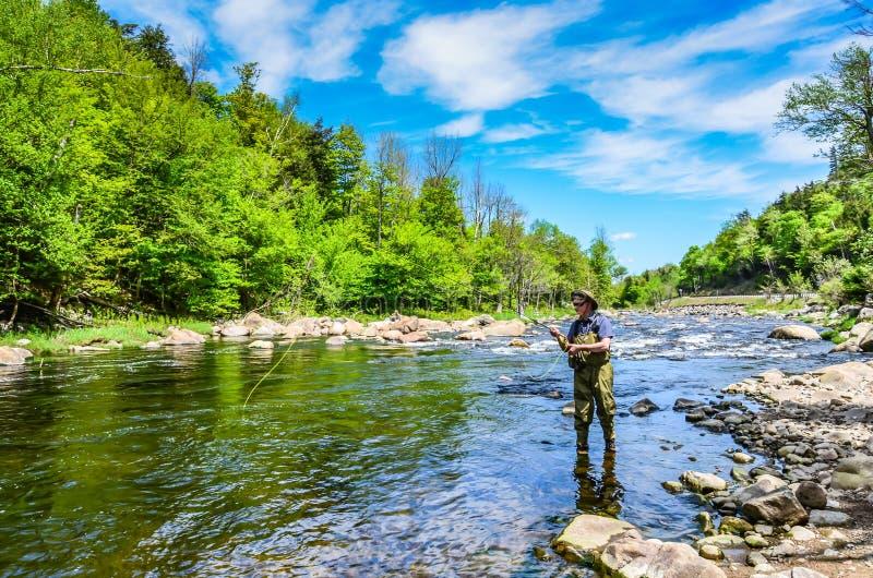Man Fishing in Lake Placid, New York stock photos