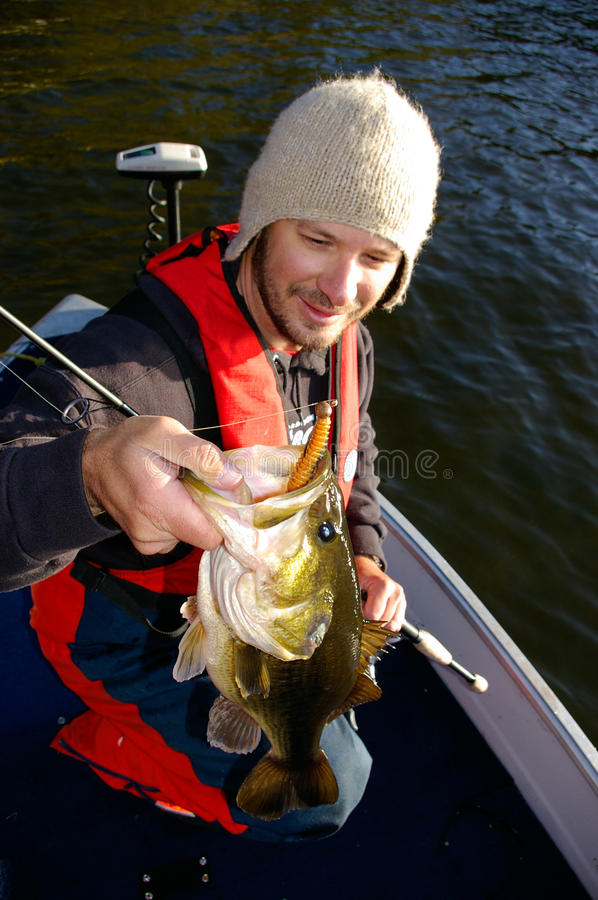 Man fishing for largemouth bass in cold weather stock for Fishing in cold weather